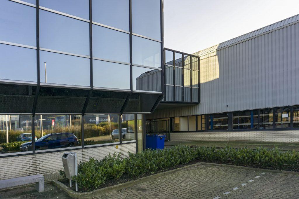 gebouw koninklijke van kempen en begeer met kantoor en bedrijfshal